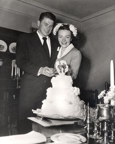 Newlyweds Ronald Reagan and Nancy Reagan cutting their wedding cake at the Holden's house in Toluca Lake, California. 3/4/52