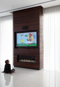 Fireplace wrap but vertical. Wrapping an unsightly pillar or inconvenient wall in wood slats and installing a television and fireplace within its design, is a great way to turn otherwise dead space in your home into a functional and unique design detail. Fireplace Tv Wall, Candles In Fireplace, Fireplace Cover, Shiplap Fireplace, Farmhouse Fireplace, Living Room With Fireplace, Fireplace Surrounds, Fireplace Design, Fireplace Drawing