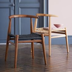John Vogel Chair - Shaped and sculpted. This chair is the result of our collaboration with South African furniture designer John Vogel, known for his signature webbed seats. To translate his detailed process into the final product, we worked with artisans in China who hand-weave each seat.