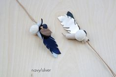 Long leather feather necklace. Feather necklace. Feather statement necklace in navy and silver. Mixed media necklace. Made to order by twobossbeads on Etsy https://www.etsy.com/au/listing/278635068/long-leather-feather-necklace-feather