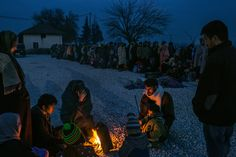 A refugee family from Syria gets warm around a bonfire as others line up to be registered in a reception camp, in Gevgelija, Macedonia (Mauricio Lima, The New York Times - November New York Times, Ny Times, Forced Migration, Moving Photos, Refugee Crisis, How To Get Warm, Best Photographers, Photojournalism, Lima