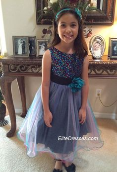"""Thank you Dayana for sharing your beautiful photo . Her comment was: """"She loved her dress!! 1st Father Daughter Dance."""" We are really happy your daughter and her daddy were able to enjoy a great Father Daughter Dance. She is wearing Girl's Black/Teal Blue Multi-colored Sequined Bodice with Layered Tulle Skirt  http://www.elitedresses.com/Girl_s_Black_Teal_Blue_Multi_colored_Sequined_Bodi_p/dkd327tb.htm #CustomerPhotos #BeautifulPicture #BeautifulDresses #FatherDaughterDance"""