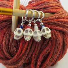 Who says your WIP has to lack style? These hand made stitch markers (pictured on circular needles) will add personality AND help you keep track of your rows! Set of 4 Circular Needles, Stitch Markers, Buy And Sell, Skull, Jewelry Making, Personalized Items, Unique, Personality, Track