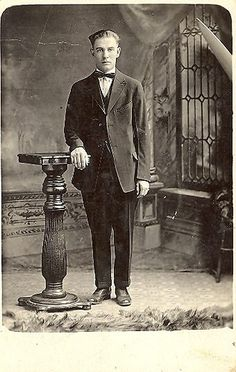 Handsome young man, c.1900   Flickr - Photo Sharing! -- probably 17-18, maybe confirmation portrait? Note wide bowtie, wider lapels, higher buttons, overall less fitted jacket than today's