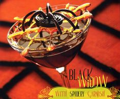 halloween cocktails - black widow martini with candy spider & spiderweb garnish