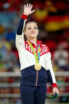 Aliya Mustafina Photos - Gold medalist Aliya Mustafina of Russia celebrates on the podium at the medal ceremony for the Women's Uneven Bars on Day 9 of the Rio 2016 Olympic Games at the Rio Olympic Arena on August 14, 2016 in Rio de Janeiro, Brazil. - Gymnastics - Artistic - Olympics: Day 9