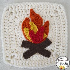 Crochet Granny Square Ideas Ravelry: Campfire Applique pattern by The Rusted Pansy - Applique is approximately tall and wide. Crochet Afghans, Crochet Motifs, Afghan Crochet Patterns, Crochet Appliques, Crochet Cushions, Crochet Pillow, Crochet Stitches, Crochet Blocks, Granny Square Crochet Pattern