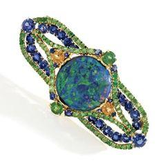 18 Karat Gold, Platinum, Opal, Sapphire, and Garnet Brooch, Louis Comfort Tiffany, Tiffany & Co., Circa 1920.