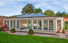 Exterior of a Timber and Glass Pool House in Essex Indoor Swimming Pools, Swimming Pool Designs, Lap Pools, Langer Pool, Westbury Gardens, Piscina Interior, Pool Enclosures, Garden Pool, Backyard Pools