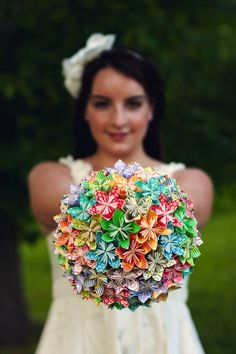 If you have been searching for a unique and alternative bouquet to carry on your wedding day which doesn't use fresh flowers, then this might be the perfect pretty option! Something which you (and even your bridesmaids) can keep well after the celebrations. Lindsey of www.lindseyfratto.com has very kindly agreed to share her DIY origami tutorial with our readers with step-by-step instructions and plenty of pictures so that you can create this bouquet for your very own wedding!