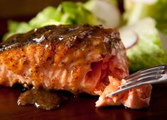 Grilling is an easy and fast way to cook salmon, and a sweet-tangy slathering of maple syrup and mustard complements the fish's meatiness.