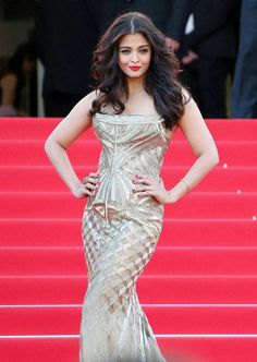 Aishwarya Rai Bachchan poses on the red carpet for the screening of Two Days, One Night (Deux jours, une nuit) at the 67th international film festival, Cannes, southern France.(AFP/)See more of: aishwarya rai bachchan