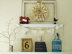 If you like the look of nature in your home — but can't handle the allergies — then use paper instead. Julie Ryan of Less Than Perfect Life of Bliss made a wreath using old book pages. To enhance the theme, she hung a leaf-shaped garland made with book pages and covered old books with black cardstock written on with chalkboard pen.
