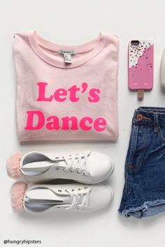 """A knit tee featuring a round neck, short sleeves, a front """"Let's Dance"""" graphic, and a cropped hem."""