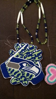 Seahawks gloves made by me (Cherylita Pierre; Flathead Tribe, 2014)