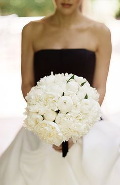 Classic white bridal bouquet for a black and white wedding dress