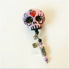 Check out this item in my Etsy shop https://www.etsy.com/listing/194606576/sugar-skull-badge-reel-pinkpurple