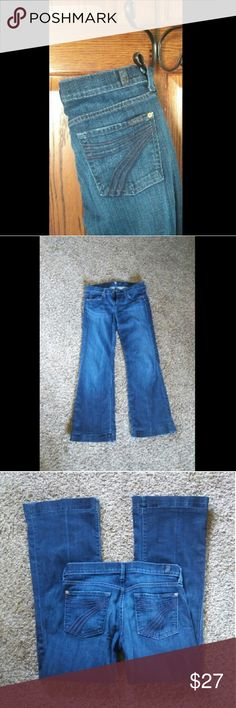 """7fam dojo jeans Dark wash 28 wide flare. """"7"""" pockets . amazing fit ! Cannot notice left leg stitching on flap is off all around pant bottom. The flap is fixable and hard to tell. Very nice 'butt' jeans ! Perfect for 7 for all mankind fan 7 For All Mankind Jeans Flare & Wide Leg"""