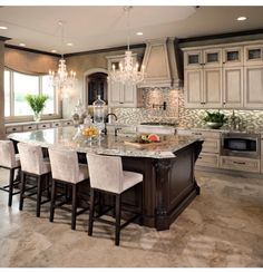 Love this kitchen, except backsplash is too busy. That is an easy fix! Layout, granite, etc. I love.