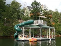 VIew from the lake.  Two story private dock with waterslide and diving.