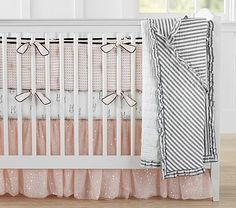 The Emily & Meritt Tada Nursery Bumper Set with Bunny Crib Fitted Sheet