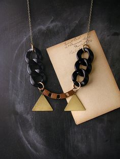 Hey, I found this really awesome Etsy listing at http://www.etsy.com/listing/95078575/geometric-necklace-double-triangles-the