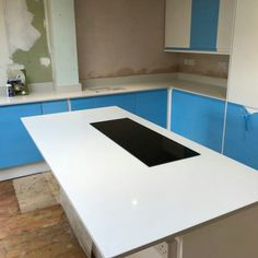 Installed The Bianco De Lusso quartz was installed in this kitchen complete with matching upstands. This white quartz with small shimmer throughout will transform any kitchen, it even works with the blue protective film on the kitchen! White Quartz, Marbles, Marble, Sculptures