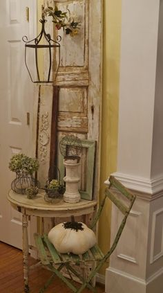 Embellish a vintage old door or shutter, add table, lantern lamp, hooks and more....  Recycle, upcycle, repurpose, salvage!  For ideas and goods shop at Estate ReSale & ReDesign, Bonita Springs, FL