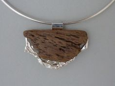driftwood and silver casted in water