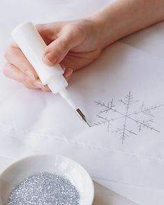 DIY Snowflake Tablecloth - the same technique could be used to make an Elsa cape - would definitely shed glitter though