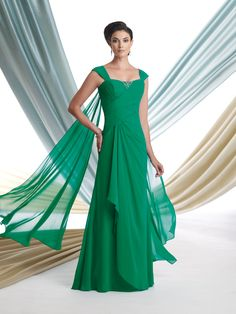 Georgette chiffon mock-wrap A-line dress with tapered shoulder straps, softly curved neckline, chevron ruched bodice with hand-beaded accent and attached back shawl, softly side draped skirt. Sizes: 4 – 20