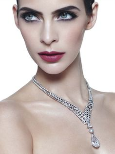 Cartier's Royal collection necklace not only features a flawless diamond but is also adorned with an openwork lattice of diamonds on the necklace which moves down the neck in a V-shape arrangement to converge in a 5.12ct kite-shaped diamond. Beyond the latticework of the main necklace, a triangular diamond is followed by a lustrous white pearl which finally brings the eye to the main wonder of the 30ct. diamond.