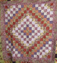 Great colors in this trip around the world quilt.