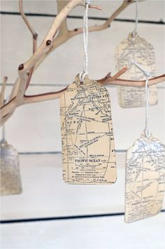 A lovely center piece, traditional wishing tree with a twist of map tags hanging from the branches. Perhaps you could leave a message to let the guests know you would like them to leave a message on them? Lovely for reading and reminiscing after the day!