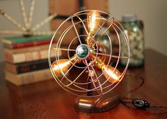 Little one ...$200....Hey, I found this really awesome Etsy listing at https://www.etsy.com/listing/115075414/compact-vintage-fan-lamp