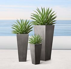 RH Modern's Salento Tapered Planters:At once modern and rustic, our faux-stone planters pair geometric silhouettes with organic texture. Each is handcrafted of durable, environmentally friendly materials that replicate the look of natural stone.