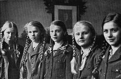 BDM (Bund Deutscher Mädel = League of German Girls) girls.  Open to girls 10 to 21. At first membership was voluntary it soon became mandatory with prison sentences for parents and children who objected to service.  Here they were taught to be the idea German woman and mother.