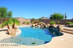 Pool and spa and 3 car garage with a trailer gate, awesome kitchen and beachwood cabinets