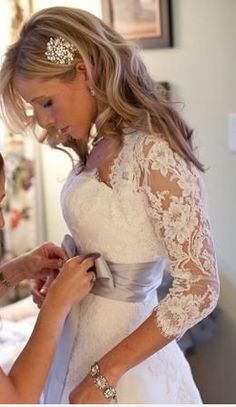 I am  HUGE fan of the lace and sleeves. Not a super fan of strapless wedding dresses. But THESE, not this is GORGEOUS!