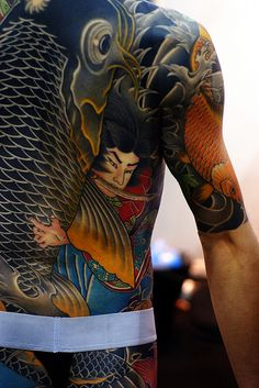 "Irizumi ~ a full body ""suit"" tattoo, traditionally associated with the Japanese Yakusa.  Carefully applied by masters, no portion of this magnificent art form could be seen while wearing clothes."