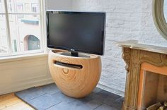 """Meet the Wooden TV Stand by Leon Van Zanten that is called the """"Bloom"""" TV stand."""