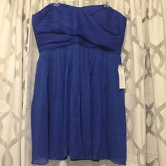 J Crew Strapless Bridemaid dress in Blue Size 20 This is a beautiful J Crew bridesmaid dress in a pretty royal blue. This is brand new with tags! It is a strapless dress that hits above the knee. There is boning along the sides to hold it's shape. J. Crew Dresses Strapless