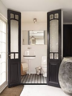 black double doors to the bath