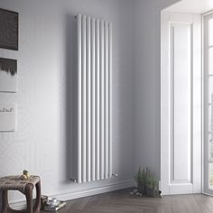 Eucotherm Nova Tube Vertical Designer Radiator - a single or double vertical oval tube radiator available in a white or anthracite finish. Upright Radiators, Tall Radiators, Vertical Radiators, Modern Radiators, Bathroom Radiators, Electric Radiators, Kitchen Radiator, Towel Radiator, Designer Radiator