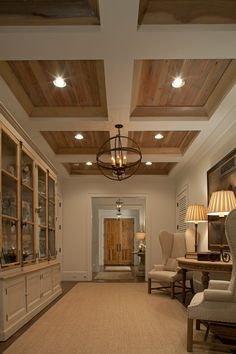 "entry space with coffered ceiling and ""barn wood"""