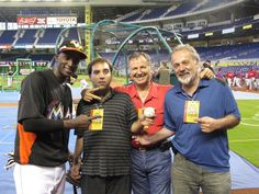 Axel Serrano poses with Miami Marlins player and family