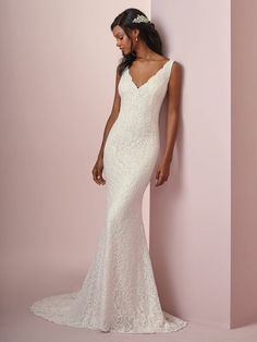 Tina by Rebecca Ingram Comprised of soft allover lace, this sheath wedding dress features chic straps and a V-neckline. V-back is accented with illusion and lace motifs. Lined with jersey for an elegant fit.