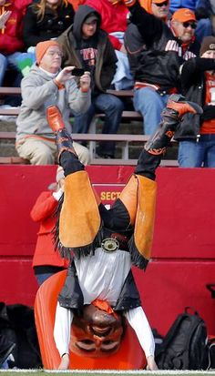 Pistol Pete does a headstand for the fans during the college football game between the Oklahoma State University Cowboys (OSU) and the Iowa State University Cyclones (ISU)