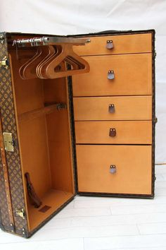 1920's Louis Vuitton Wardrobe Trunk | From a unique collection of antique and modern trunks and luggage at http://www.1stdibs.com/furniture/more-furniture-collectibles/trunks-luggage/
