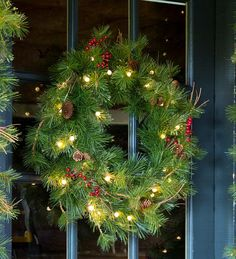 lighted outdoor battery operated holiday wreath with auto timer holiday greenery